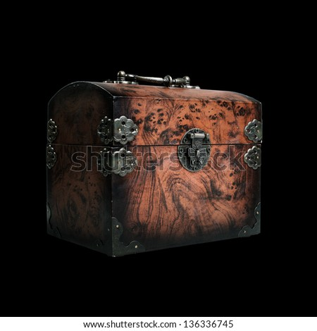 close wooden chest isolated on black background - stock photo