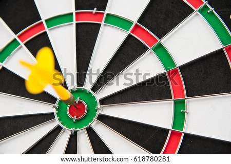 Close yellow dart on target board left frame