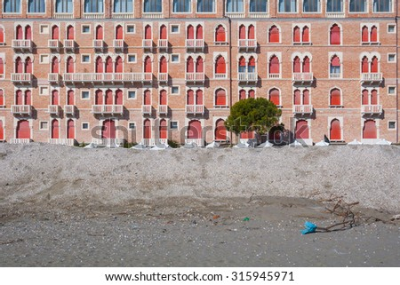 Closed are not in season, the windows of the hotel. Winter on the famous Lido adriatic Beach in Venice, Italy. - stock photo