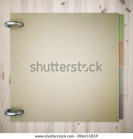 Closed blank notepad with colorful stickers inside on wooden background. Mock up, 3D Render - stock photo