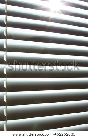closed blinds at the window, office