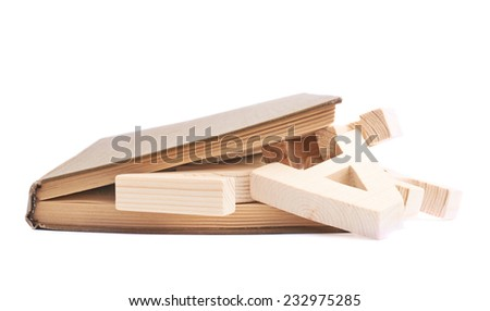 Closed book with the wooden letters between the pages, composition isolated over the white background - stock photo