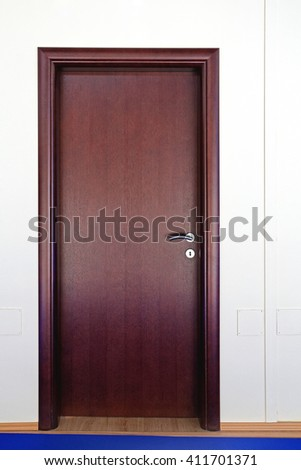 Closed Brown Door at Home Interior - stock photo