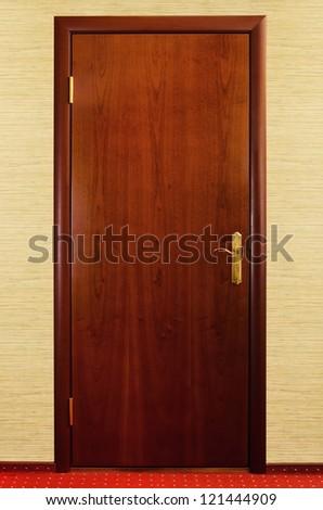 Closed Brown Wooden Door To The Room