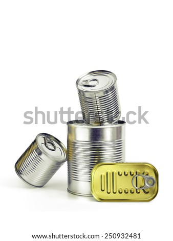 Closed cans of conserved food over a white background - stock photo