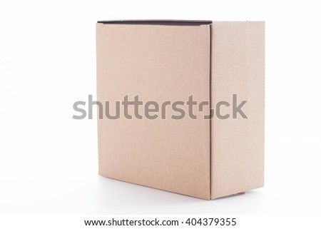 Closed cardboard box on white background. - stock photo