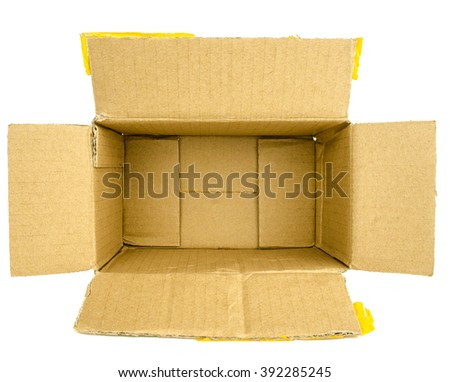 Closed cardboard box taped up with yellow scotch masking tape  and isolated  on a white background / Cardboard box front side with isolated on white - stock photo
