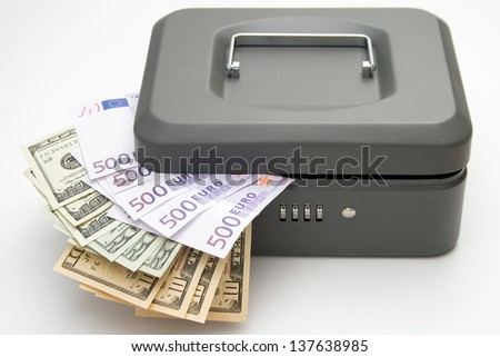 Closed cashbox and money on white background - stock photo