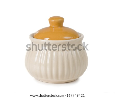 closed ceramic sugar bowl on a white background