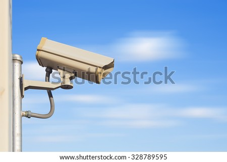Closed circuit camera with blue sky background.
