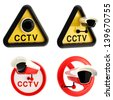 Closed circuit television CCTV alert sign with real camera isolated over white, set of four - stock photo