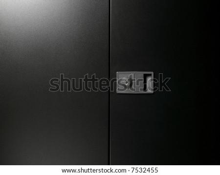 closed closet with door handle - stock photo