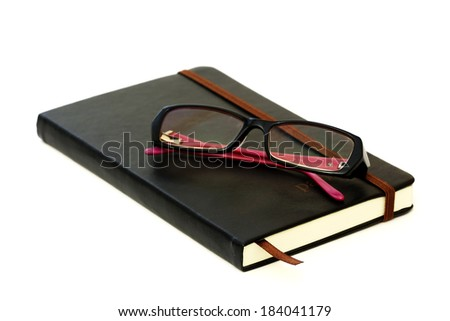 Closed dairy book and glasses - stock photo
