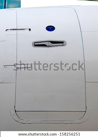 Closed door on a airplane - stock photo