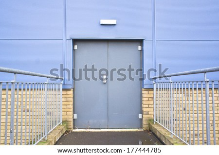 Closed double door in an industrial building - stock photo