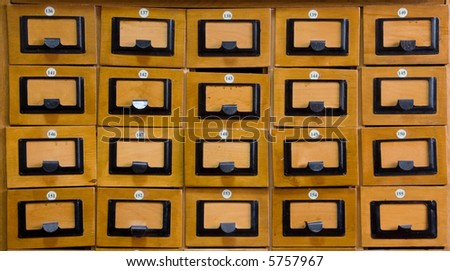 Closed drawers in the library wood catalog. - stock photo