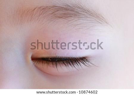 Closed eye of sleeping baby girl - stock photo