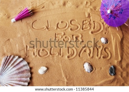 Closed for holidays written on sand with colorful umbrellas and seashells. Soft focus for dreamy atmosphere. - stock photo