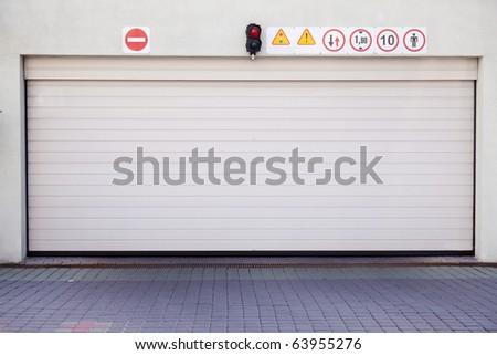 Closed garage gate in modern building - stock photo