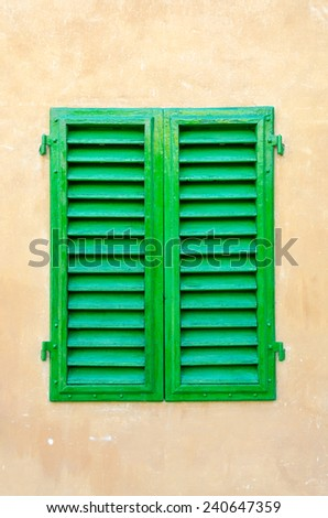 Closed green window on the brown wall. Italy. Florence. - stock photo
