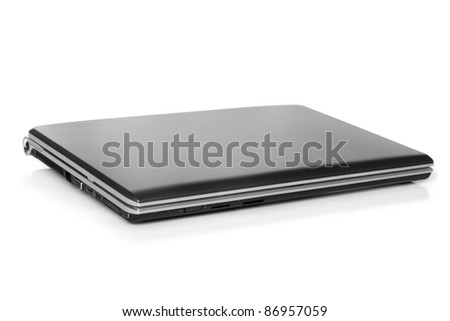 Closed laptop on a white background - stock photo