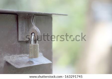 closed metal door with loc - stock photo