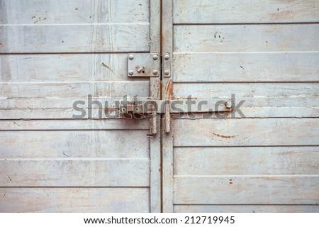 closed metal door with lock - stock photo