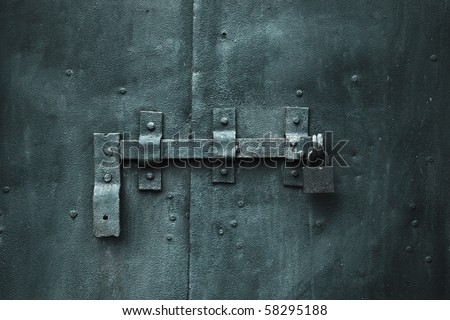 closed metal door with lock - stock photo