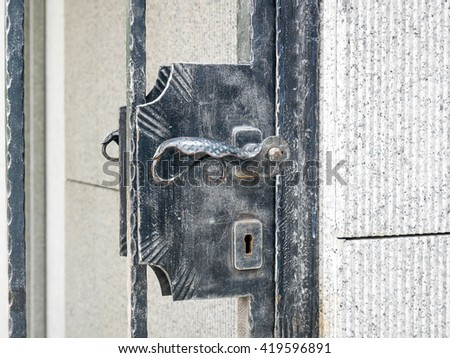 Closed metal door with the two locks.
