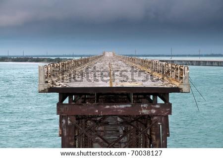 Closed part of Bahia Honda rail bridge in perspective - stock photo