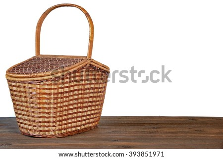 Closed Picnic Basket Or Hamper On  The Brown Rustic Wooden Table Isolated  On White Background, Front View, Copy Space - stock photo