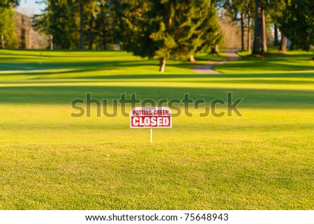 Closed putting green in winter - stock photo