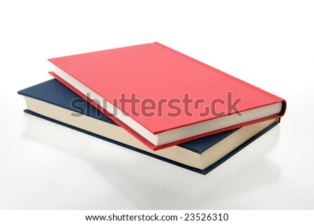 closed red and blue books on a reflecting white background - stock photo