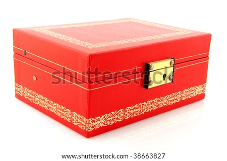 closed red box with golden decoration isolated over white