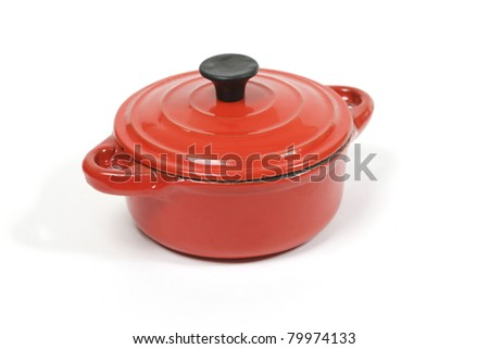 Closed red casserole in close up - stock photo