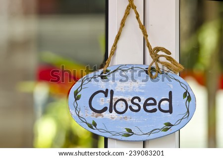 closed sign board hang on the door - stock photo