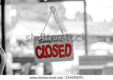 closed sign board hang on the door (Red color selection on this picture) - stock photo