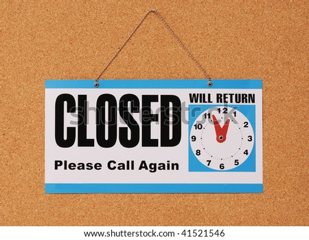 closed  sign hanging at door - stock photo