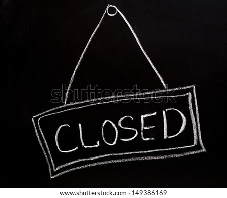 Closed sign made on a blackboard - stock photo