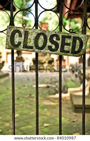 Closed sign on metal doors with bars - stock photo