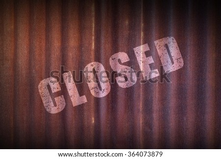 Closed sign on old zinc sheet rust background. - stock photo