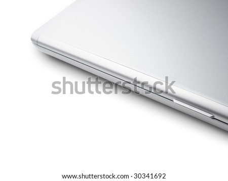 closed silver laptop isolated on pure white with large copy space - stock photo