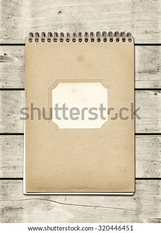 Closed spiral Note book on a white wood table. Mockup - stock photo