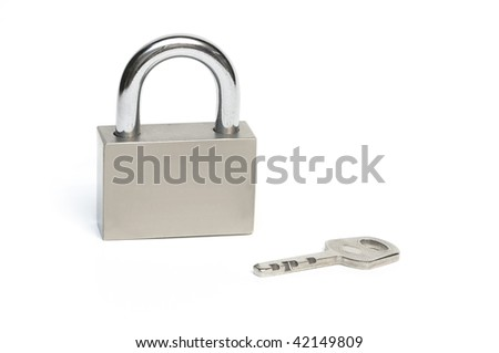 Closed steel padlock with key. Background white.