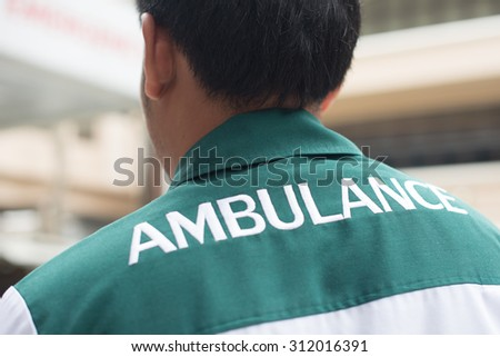 Closed up : Emergency medical technician uniform backside show ambulance wording - stock photo