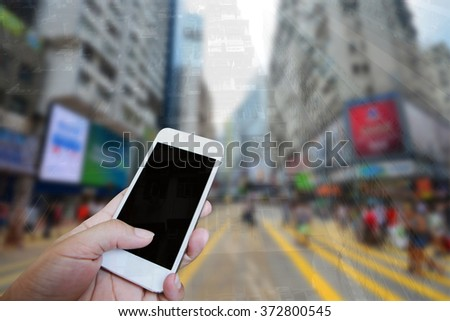 Closed up hand of man using smartphone at the street - stock photo