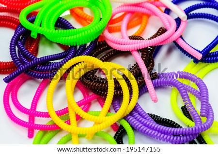 closed up of fresh multicolor beads on white background - stock photo
