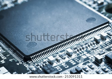 Closed up of microprocessor on motherboard. Shallow depth of field. - stock photo