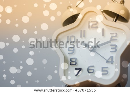 Closed up of modern white clock on background with bokeh and sun light