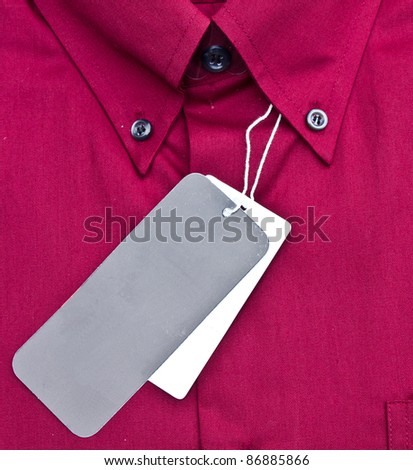 closed up of the red shirt with black & white tag